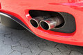 Emission pipe of a red car Royalty Free Stock Photo