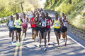 Emmanual bett from kenya leads the men at the lilac bloomsday k run in spokane wa s elite division down first hill background Stock Photo