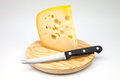 Emmental cheese on a cutting board Stock Photos