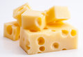 Emmental cheese portions on white base Stock Photo