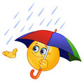Emoticon with umbrella Stock Photos