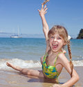 Emotion girl  at sea coast. Stock Image