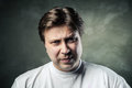 Emotional angry middle aged man over gray Royalty Free Stock Photo