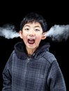 Emotional Boy with Steam Coming From Ears Royalty Free Stock Photo