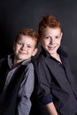 Emotional boys in the studio portrait of an red haired on a black background Stock Image