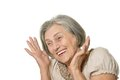 Emotional elderly woman on a white background Stock Image