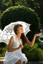 Emotional lady with white umbrella Stock Image