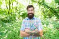 Emotional nature lover. Man bearded hipster green trees background. Guy relax in summer nature. Man handsome beard and Royalty Free Stock Photo