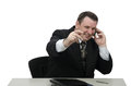 Emotional officeman talks on the phone Royalty Free Stock Images