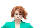 Emotional red haired woman in doubt isolated on white background Royalty Free Stock Photos