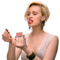 Emotional sexy woman posing with cigarette and matches on a white background Royalty Free Stock Photo