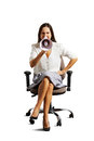 Emotional woman sitting on the office chair and shouting at megaphone isolated white background Stock Image