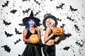 Emotional young women in halloween costumes. Royalty Free Stock Photo
