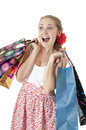 Emotionally happy young girl  holding shopping gift bags. Stock Photos