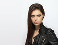 Emotive closeup portrait of a young attractive brunette woman posing for model tests in black leather jacket Royalty Free Stock Photo