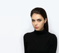 Emotive closeup portrait of a young attractive brunette woman posing for model tests Royalty Free Stock Photo