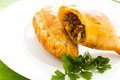 Empanada stuffed with bread on a white plate Royalty Free Stock Photo