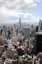 Empire state building new york manhattan usa from the top of the spectacular sky with clouds the is a story Royalty Free Stock Photos