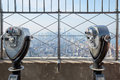 Empire State Building observation deck with binoculars in New York Royalty Free Stock Photo