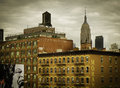 Empire state building and water tower new york a view of the amid apartment buildings in the city neighborhood of chelsea Royalty Free Stock Photos