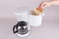 Employ coffee filter in coffee maker a woman the the machine with hand Royalty Free Stock Photo