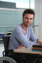 Employability man sat at a desk at his workplace Royalty Free Stock Image