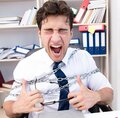 The employee attached and chained to his desk with chain Royalty Free Stock Photo