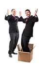 Employee delivery two businessman standing on a white background one of them is popping out of a box Royalty Free Stock Photo