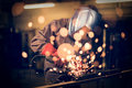 Employee grinding steel with sparks worker focus on grinder Royalty Free Stock Photography