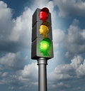 Employee guidance and human direction as a business and career concept as traffic lights with red yellow and a glowing bright Stock Photo
