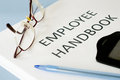 Employee handbook on blue background Royalty Free Stock Images