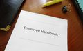 Employee handbook document on an office desk Royalty Free Stock Images