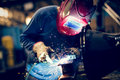Employee welding steel with sparks using mig mag welder Royalty Free Stock Photo