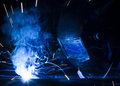 Employee welding using MIG/MAG. Royalty Free Stock Photo