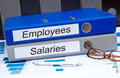 Employees and salaries two binders on desk in the office Stock Photo