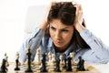 Empresaria preocupante joven in front of the chessboard Fotografía de archivo