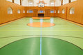 Empt basketbally interior of public empty gym with basketball court Royalty Free Stock Photo