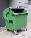 Emptied garbage bin on a street Royalty Free Stock Photography