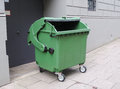 Emptied garbage bin on a street Stock Images