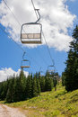 Emptiness in the ski area empty lift seats alpine summer landscape Royalty Free Stock Photos