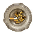 Empty 9mm bullet casings in an old tin ashtray Stock Image