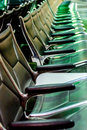 Empty airport seating - typical black chairs in boarding waiting Royalty Free Stock Photo