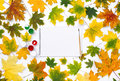 Empty album with paints in the frame of autumn leaves Royalty Free Stock Photo
