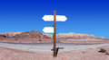 Empty arrow shaped signs in the middle of the desert Royalty Free Stock Photo