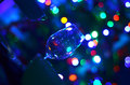 Empty askew wine glass detail and abstact night blury defocus bokeh light background photography Royalty Free Stock Photo