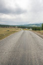 Empty asphalt road leading to mountains