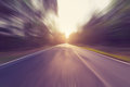 Empty asphalt road in motion blur and sunlight Royalty Free Stock Photo
