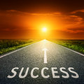 Empty asphalt road and sign symbolizing success Royalty Free Stock Photo