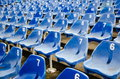 Empty auditorium with blue numbered chairs Royalty Free Stock Photo