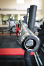 Empty barbell bar waiting to workout shallow dof Stock Photography